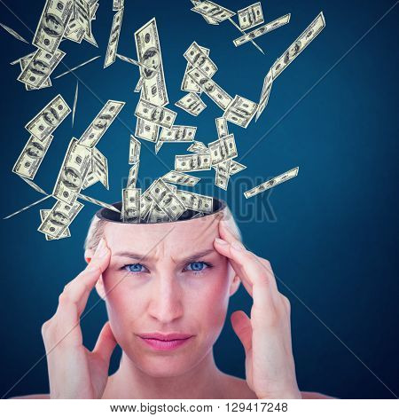Pretty blonde suffering from headache looking at camera against teal, blue background