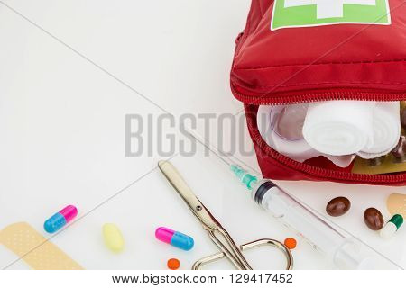 Opened First Aid Kit With Medical Equipment, Isolated On White Background With Copy-space