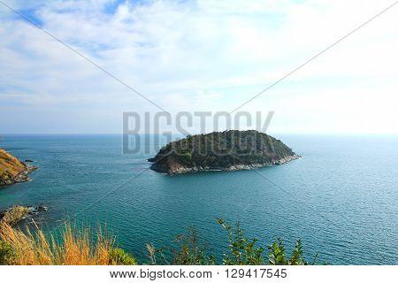 A small island lies off the coast of Phuket Thailand.