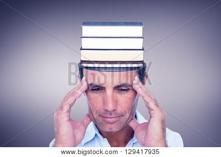 Handsome man thinking with hand on forehead against grey vignette