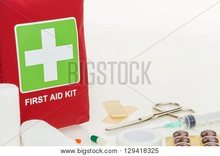 First Aid Kit With Medical Equipment, On White Background With Copy-space