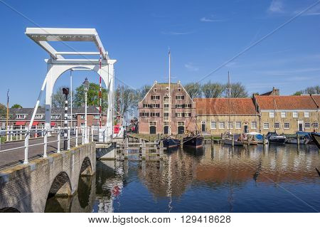 ENKHUIZEN, NETHERLANDS - MAY 9, 2016: Old building the Peperhuis and bridge in Enkhuizen, Netherlands