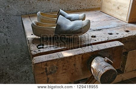 Old Dutch Wooden Clogs In The Shoemaker's Workbench