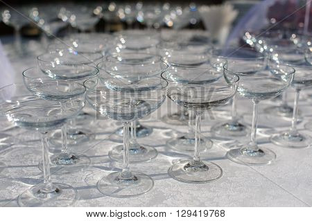 Empty cocktail glasses martini on the table. White tablecloth.