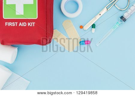 First Aid Kit With Medical Equipment, On Light Blue Background With Copy-space