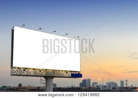 the empty advertisement board beside the highway road with the twiglight scene