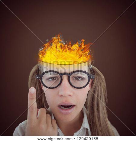Female geeky hipster looking confused against dark brown background
