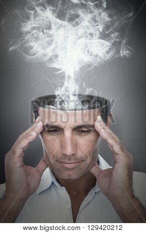 Handsome man thinking with hand on forehead against digital image of gray wall