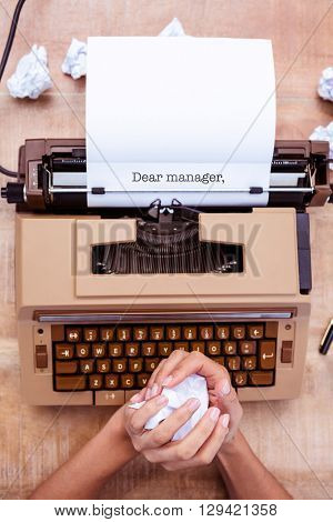 The word dear manager, against above view of old typewriter