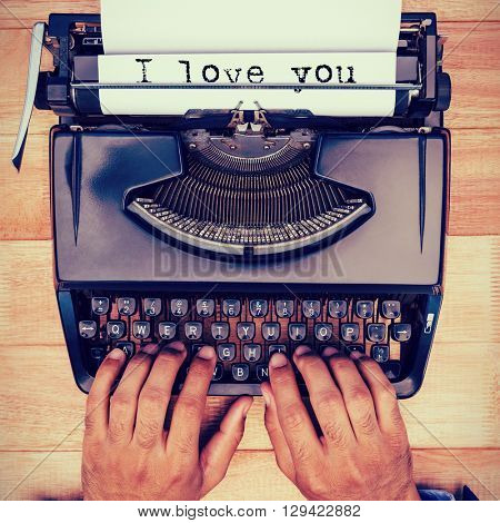The sentence I love you against white background against businessman typing on typewriter