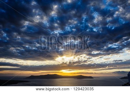 Dramatic sunset over Santorini caldera sea