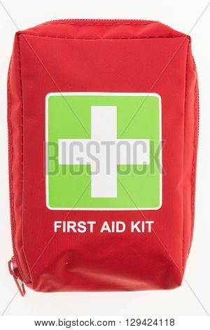 Red first aid kit isolated on white background.