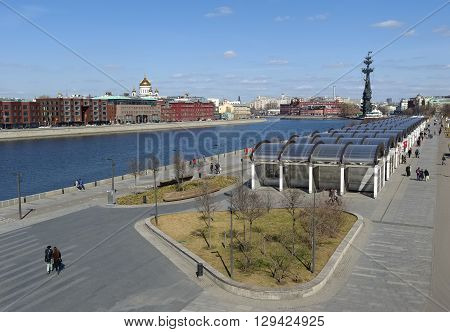 MOSCOW, RUSSIA - APRIL 12, 2016: Panoramic view of Moscow from Krymsky Bridge View of Krymskaya Embankment in heart of Christ the Savior Cathedral on the right the monument Peter I