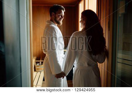 Couple enjoying finnish sauna during their spa weekend