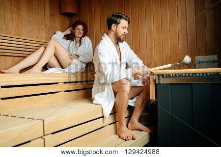 Couple resting and sweating in a sauna