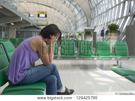 Portrait of a tired and sad adult woman. Airport waiting room.