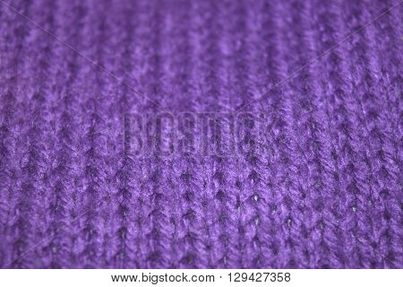 close up knitted texture fabric background in purple wool