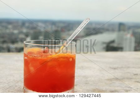Fruity cocktail with Bangkok city in the background from the Lebua Hotel in Thailand