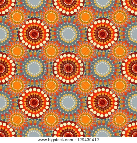 Seamless vintage retro pattern orange textile. Circles and circular patterns. Ethnic motif. Fabric and vector background. Autumn warm Sunny colors
