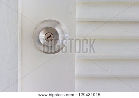 steel door knob on the white door