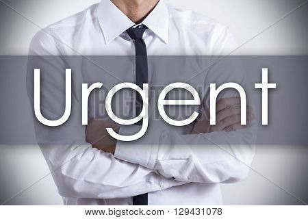 Urgent - Young Businessman With Text - Business Concept
