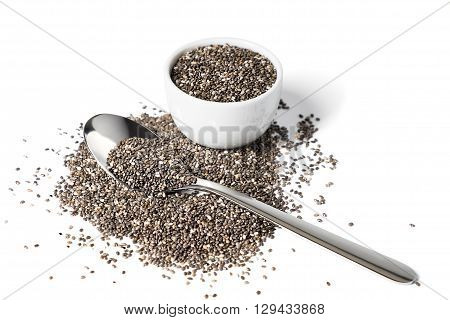 Chia seeds in spoon and small cup isolated on white background selective focus.
