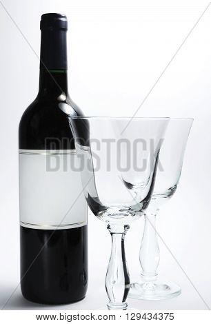 red wine bottle and wine glasses, studio shot
