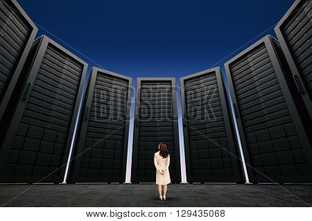 Rear view of businesswoman against blue and purple sky