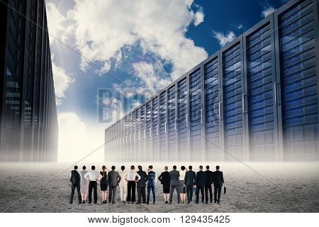 Rear view of multiethnic business people standing side by side against server hallway in desert