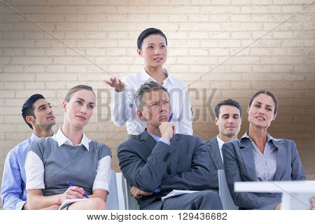 business team during a meeting against white wall