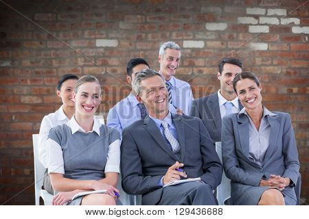 business team during a meeting against brick wall
