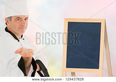Male chef presenting an invisible product against sun is up