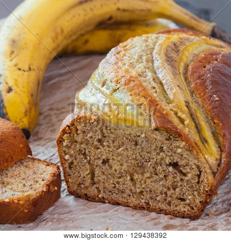 Banana loaf multigrain bread biscuit cake, healthy snack on a grey table