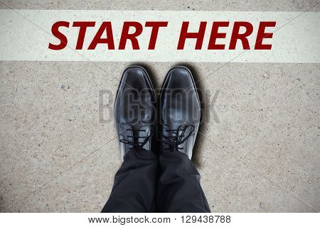 Businessmans feet in black brogues against path
