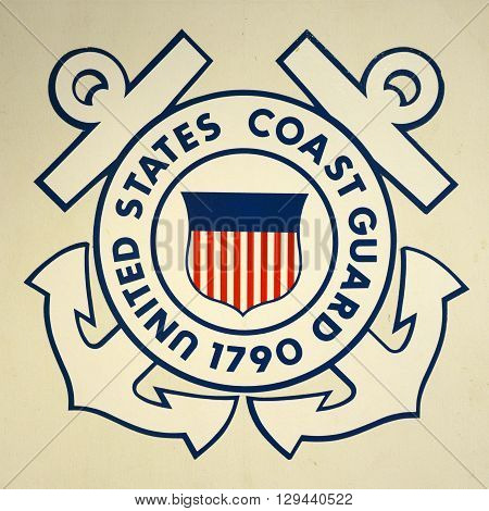 KEY WEST, FL, USA - DEC 20: United States Coast Guard Insignia on USCGC Ingham (WHEC-35) on Dec 20, 2012 in Key West, Florida, USA.