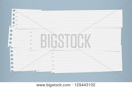 Pieces of cut white squared, lined notebook paper are stacked on blue background.