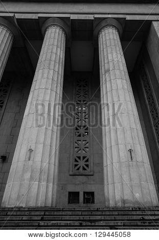 Large massive stone pillars on the building