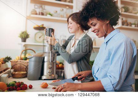 Two Women Preparing Fruit Juice At Cafe