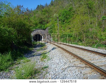 Railway Leading To The Dark Tunnel Entrance
