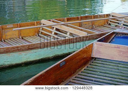 Close up of empty coloured punts on the River Cam, Cambridge, England.
