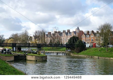 Chesterton Road and the lock, weir and pedestrian footbridge near Jesus Green in Cambridge, UK.