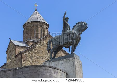 Tbilisi, Georgia - May 07: The Statue Of David The Builder In Front Of The Virgin Mary Metekhi Churc