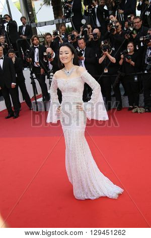 Gong Li attends the 'Cafe Society' premiere and the Opening Night Gala during the 69th Cannes Film Festival at the Palais des Festivals on May 11, 2016 in Cannes, France.