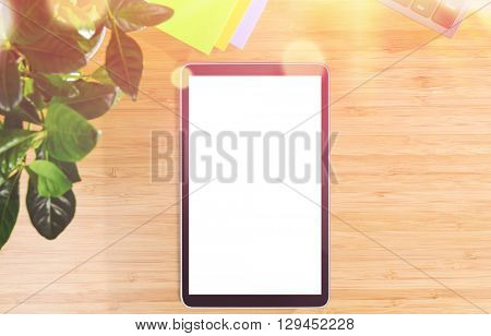 wooden table with tablet pc and office related objects, modern stylish work place, view from above