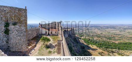 Almourol, Portugal - July 24, 2015: Marvao Castle bailey and keep with a view of the Alto Alentejo landscape. Marvao, Portalegre District, Portugal.