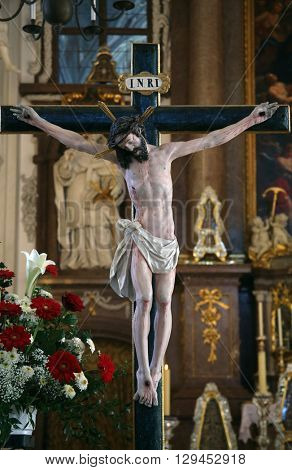 BENEDIKTBEUERN, GERMANY - OCTOBER 19: Crucifixion, altar in Saint Benedict basilica in the famous Benediktbeuern abbey, Germany on October 19, 2014.