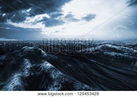Rough blue ocean against orange and blue sky with clouds