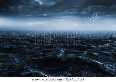 Rough blue ocean against rugby pitch