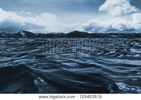 Blue rough ocean against blue sky