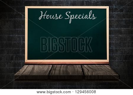 House specials message against blackboard on a wooden shelf